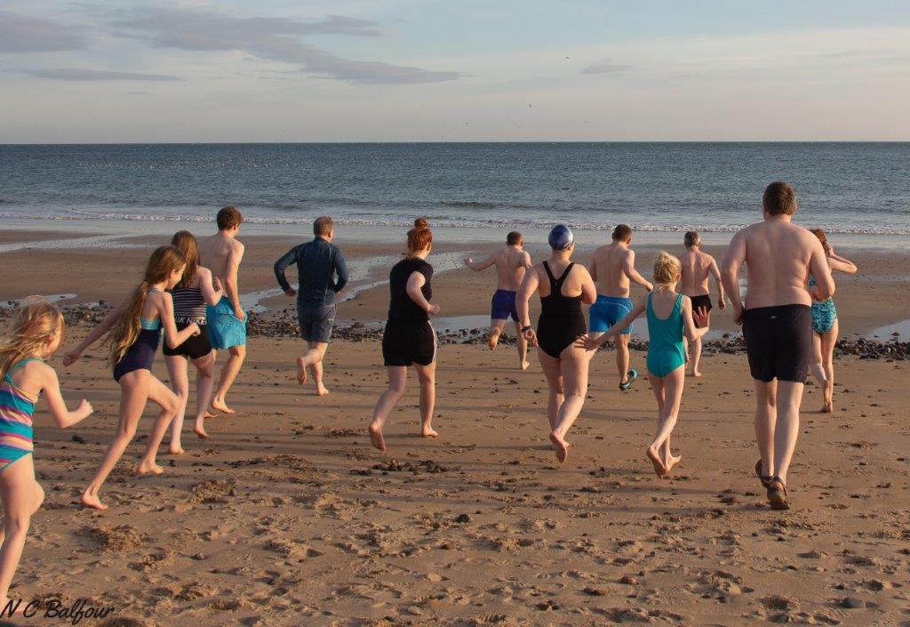 New Year dip, wild swimmers on Shandwick Beach