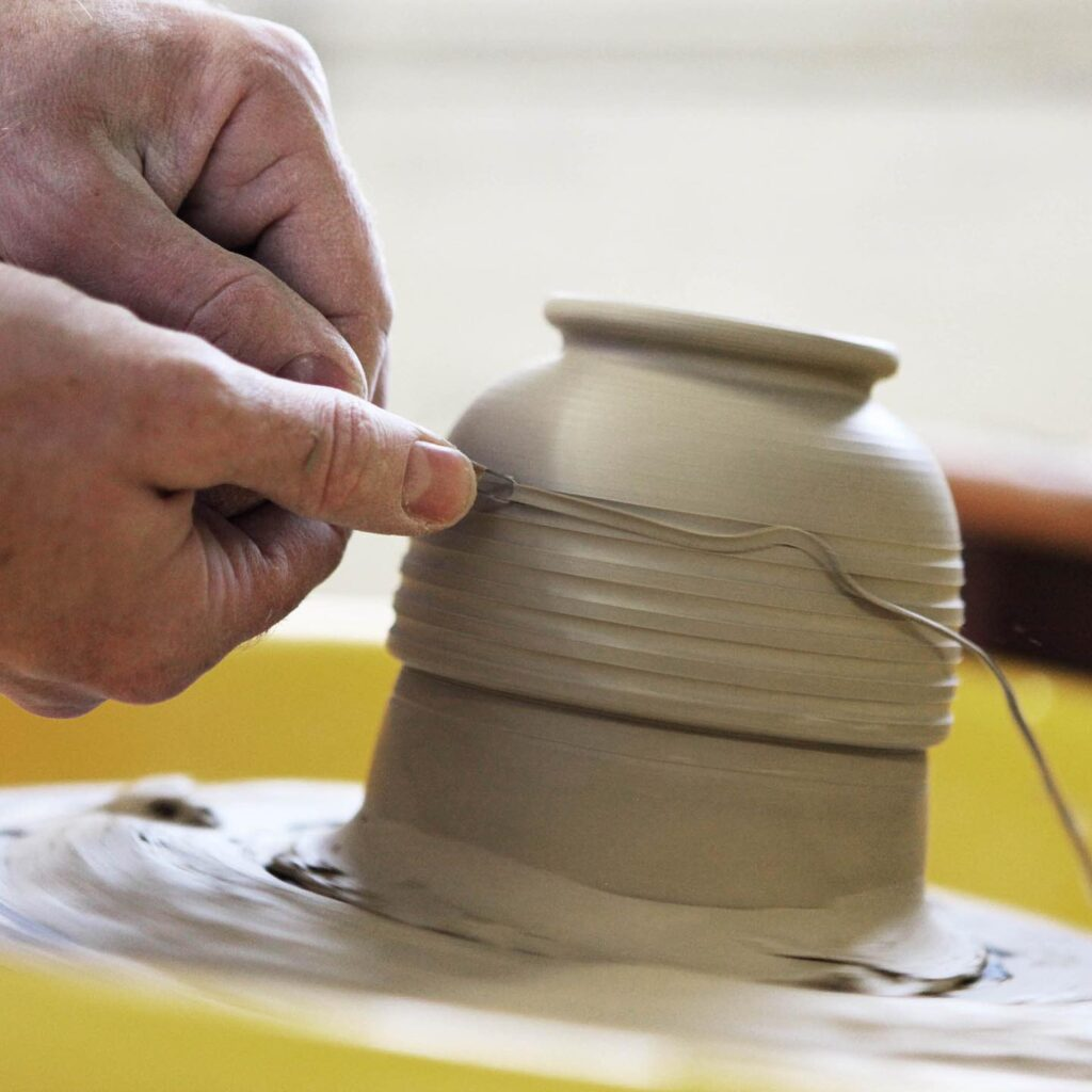 pottery being thrown on a wheel
