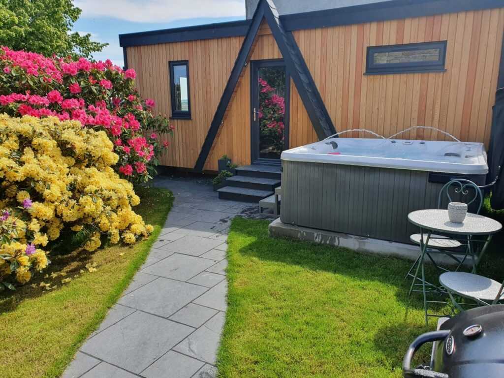 Outside Little woodbine and view of garden and hot tub